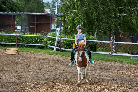 June 21 2020 Minsk Belarus A young teenage girl rides a harse