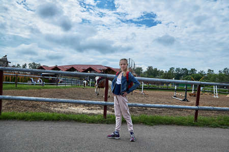 June 21 2020 Minsk Belarus Beautiful teen stands on the road to the Park in the city