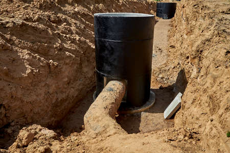 Entering an old water pipe into a reinforced concrete well.Reconstruction of the old water supply system