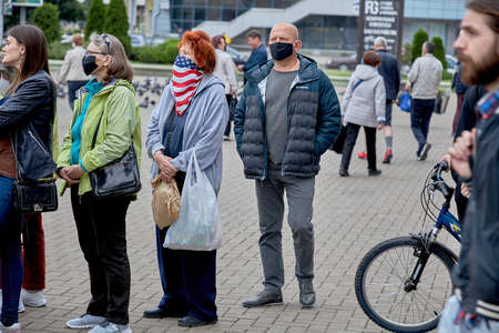 June 14 2020 Minsk Belarus An elderly woman in a mask of the color of the United States stands in line to leave signatures for possible presidential candidates