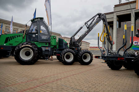 July 3 2020 Minsk Belarus People walk among the exhibition of construction and agricultural machinery on the square