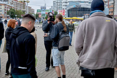 June 14 2020 Minsk Belarus An operator with a large camera takes a video of a talking person