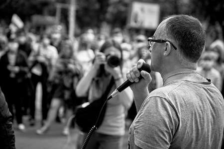 June 7 2020 Minsk Belarus Close-up of an opposition leader with a microphone speaking at a protest rally, when a photographer takes it 新聞圖片