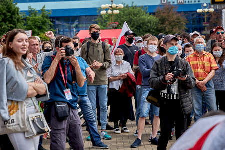 June 7 2020 Minsk Belarus Many masked people and photographers stand at a protest rally in the city square