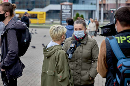 June 14 2020 Minsk Belarus A masked woman answers questions from a reporter with a microphone at a protest rally