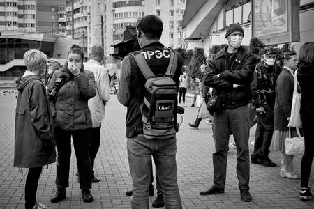 June 14 2020 Minsk Belarus A masked woman answers questions from a reporter with a microphone and a man with a camera at a protest rally
