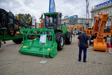 July 3 2020 Minsk Belarus People walk among the exhibition of construction and agricultural machinery arranged on the square 新聞圖片