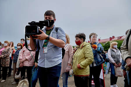 June 7 2020 Minsk Belarus A man with a large camera takes video of people at a protest rally