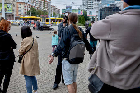 June 14 2020 Minsk Belarus A man with a backpack answers questions from a man with a large camera