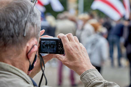 June 14 2020 Minsk Belarus A rally where a man takes a video on an old camera of a protest action