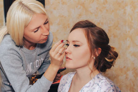 August 10, 2019 Minsk Belarus Makeup artist doing hairstyle to girl