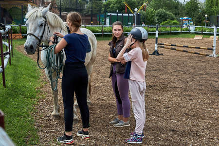 June 21 2020 Minsk Belarus A young teenage girl rides a horse 新聞圖片