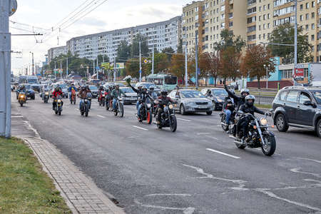August 15 2020 Minsk Belarus A motorcyclists with flowers rides on the road