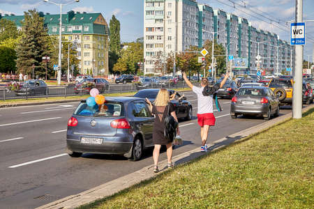 August 15 2020 Minsk Belarus A couple with their hands raised in protest are walking