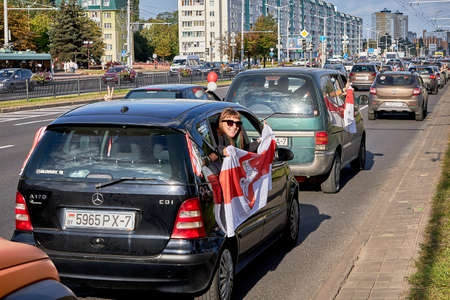 August 15 2020 Minsk Belarus A car with an opposition flag and a stop dictator poster 新聞圖片