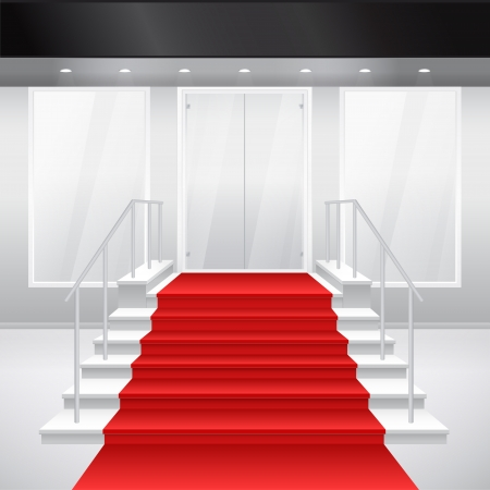 entrance: Entry to shop with stairs and red carpet. of entrance to building. Exterior of store in gray color