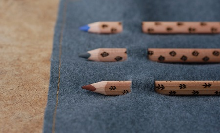 pencil case: three wooden pencils in pencil case on the texture Stock Photo