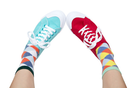wearing funny socks and different sneakers on legs Stockfoto