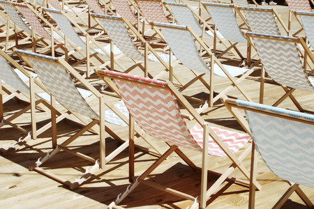 many colored: many colored patterned chairs chaise-longue on event Stock Photo