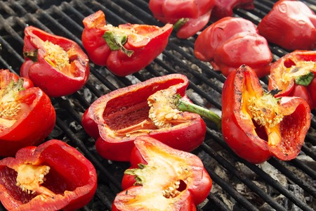Background, texture of vegetables on the grill bbq. Vegetables on the grill bbq. Red peppers on the Grill. Stock Photo
