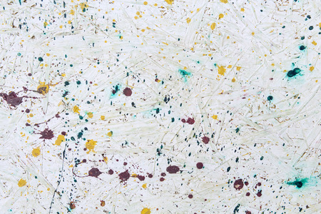 bedraggled: Background in Jacksons Pollock style. Old paint on the wall of white color, texture. Bedraggled, sloppy pattern.