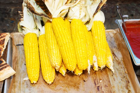 Background, texture of Organic Corn with pita cooked on the grill bbq. Vegetables cooked on the grill bbq. Organic Corn on the Grill.