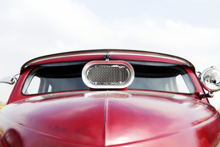 Customized vintage car on a festival of old cars. Retro cars windshield close up.