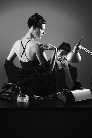 film noir: Film noir: romantic loving couple embracing in the dark, 1950s style Stock Photo