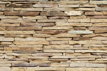 Achtergrond van smalle bakstenen nieuwe muur, textuur Stockfoto