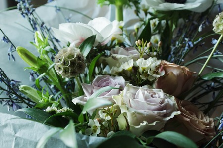 Flower arrangement with branches of a pistachio branches of Ruscus, carnations, roses, branch of Brunei, berries of Hypericum. Wedding concept