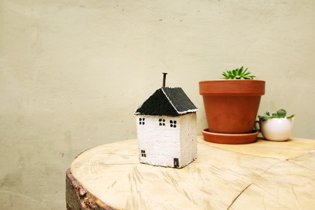 model of house as symbol on wall background