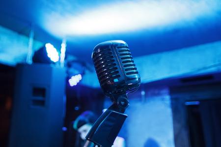 Retro microphone against blur colorful light restaurant background