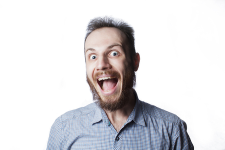 expression and people concept - man with funny face over white background Stockfoto