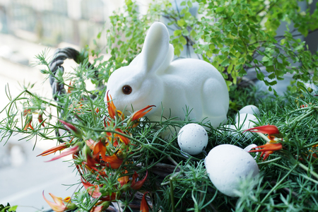 basket with white easter bunny and eggs