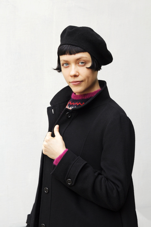 Attractive elegant young woman wearing a black beret