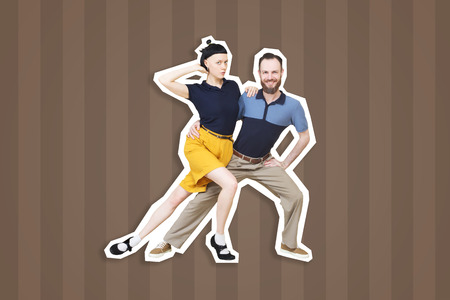 Lindy hop or rocknroll dance boogie woogie. Boogie acrobatic stunt in a studio background. Dance for rock-n-roll music.