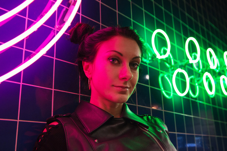 Cinematic night portrait of girl and neon lights in night club Stockfoto