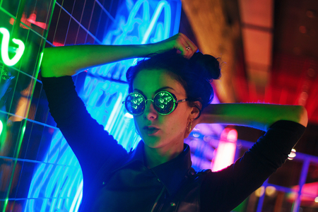 Cinematic night portrait of girl and neon lights in night club Stockfoto - 126714707
