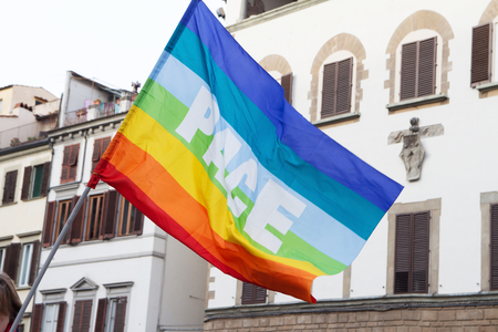 demonstration on the street of Florence in Italy, peace rainbow flag Stockfoto - 126714800