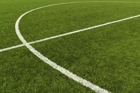 Artificial turf soccer field and the middle line photo