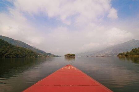 skiff: caique on phewa lake pokhara nepal