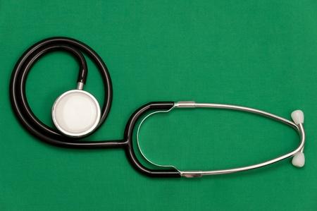 stetoscope: stetoscope on the green suit Stock Photo