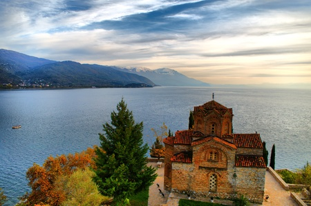 Church of saint john the theologian at kaneo, overlooking lake ohrid photo