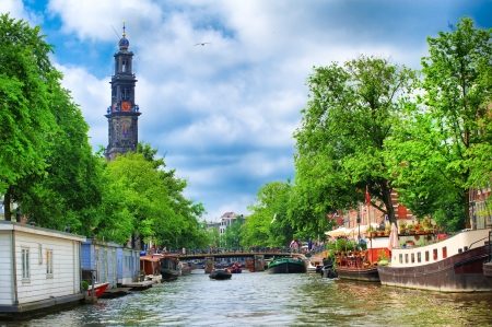 amsterdam canal: Westerkerk clock tower in Amsterdam