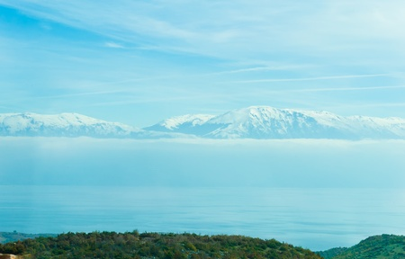 Blue snowy mountains view from Ohrid Lake in Macedonia photo
