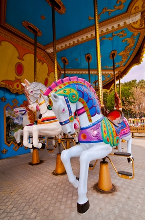 Colorful horses in the carousel photo
