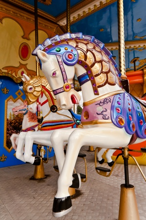 Colorful horse in carousel photo