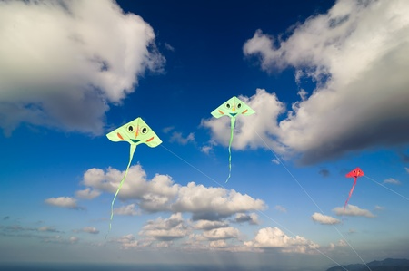 Flying colourful kites in blue sky photo