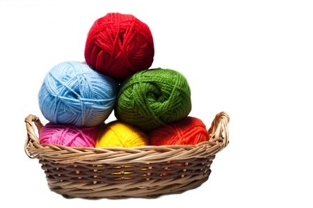 acrylic fiber: isolated colorful acrylic fibers in the basket on white background