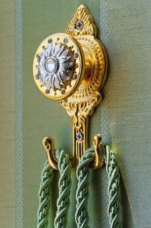 yellow tassel: Yellow metal curtain holder with tassel rope